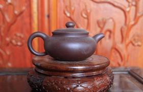 古紫砂壶有异味还可以用吗?
