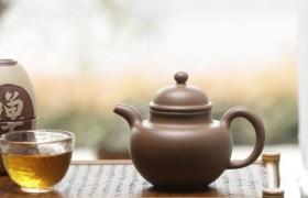 紫砂壶泡久了,残留的茶垢是越厚越好吗?