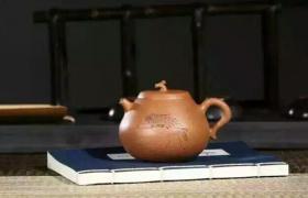 如何把紫砂壶的茶垢清理干净?
