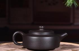 为什么我的紫砂壶开壶后,表面出现一层白雾?