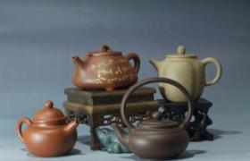你是怎么拿紫砂壶的?持壶倒茶的手势你知道吗
